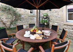Courtyard at Brokenheugh Self-catering Lodge, in Haydon Bridge near Hexham and Hadrians Wall, Northumberland, UK